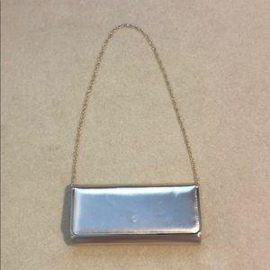 Gold Aldo convertible clutch/shoulder bag